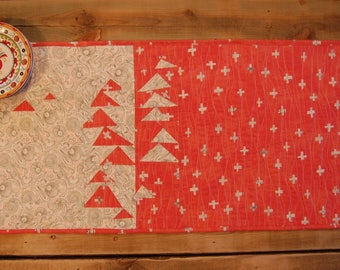 "Quilted table runner in soft orange, cream and black in improv flying geese pattern 16 1/2"" x 34 1/2"""