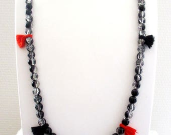 Ethnic, feminine necklace made of beads and tassels