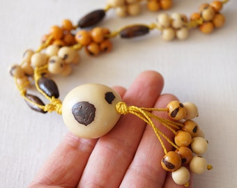 Inspirational 70s necklace tassel necklace Tagua Nut Bead ivory palm necklace yellow multi-string long necklace hand knotted necklace boho