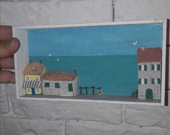 Small town houses on sea side diorama