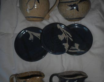 8 piece pottery set, sugar creamer, spoon plates