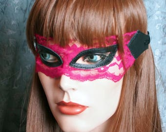 Playful cherry red and black lace mask