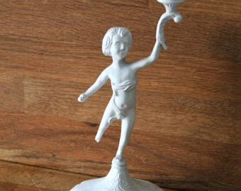 White painted candlestick.  Shabby chic candlestick.  Boy holding a candle holder.  Vintage candlestick. Candle holder. Vintage lighting