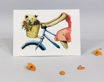 Note card with dog in a bike basket with flowers. Small note card with choice of envelope, blank inside.