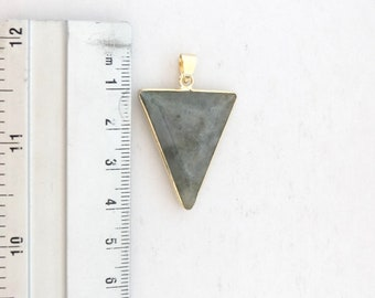 Grey stone and metal pendant gold