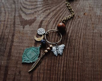 gypsy moth. a bohemian eclectic moon, moth, feather and stone trinket necklace