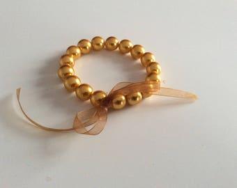 "Bracelet ""renaissance"" glass beads and organza bow."