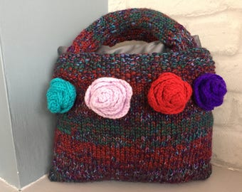 Handmade knitted top handle bag.