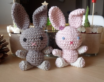 Pair of Mr. and Mrs Bunny amigurumi bunnies, pink and gray