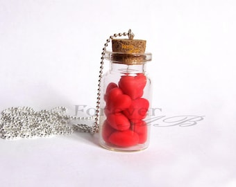 Bottle necklace with hearts