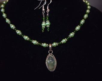 Prehenite pendant with green glass beads