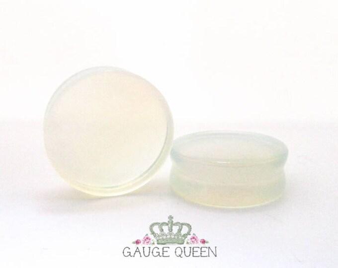 """Opalite Stone Plugs / Gauges. 4g /5mm, 2g /6.5mm, 0g /8mm, 00g /10mm, 1/2"""" /12.5mm, 9/16"""" /14mm, 5/8"""" /16mm, 3/4"""" /19mm, 7/8"""" /22mm,1"""" /25mm"""