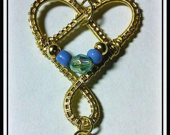 Wire wrap weave heart shaped pendant with a blue lampwork heart dangle