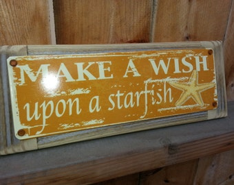 Wish upon on a starfish metal street sign