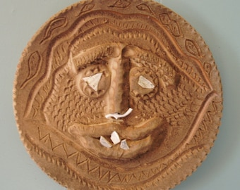 African style pottery mask with pierced nose