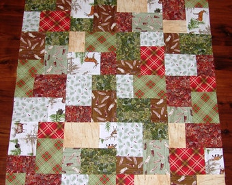 Unfinished lap/baby quilt TOP featuring the woodland or lodge look in a random pattern.  colors, red, green, brown, white, tan