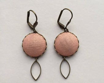 brass earrings and vintage pink fabric