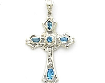 Sterling Silver Cross pendant with Blue Topaz stones.