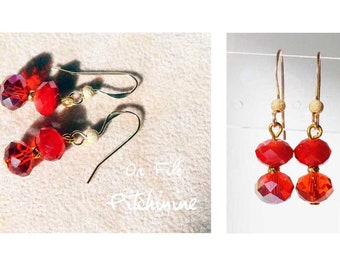 simplicity, elegance to these earrings gold gold filled and its red crystals