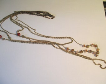 Vintage Jewelry   gold tone 3 chain waterfall necklace with faceted crystal beads 42 inch no markings.