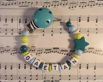 Pacifier clip with turquoise Star Baby