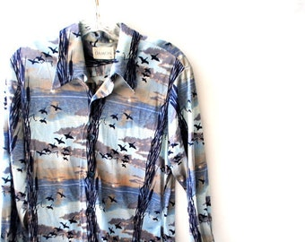 Retro vintage 70s,pastel blue, gray, beige nylon men's shirt with a a navy blue ducks print. Made by Damon. Size M.