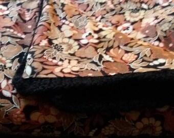 Black and orange crochet baby blanket