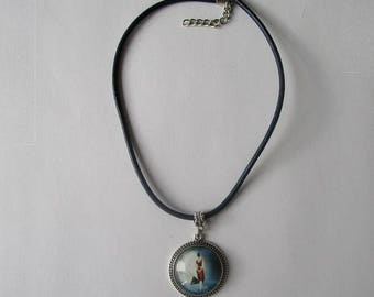 woman walking towards the Moon necklace