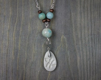 Essential oil diffuser necklace with  leaf-stamped clay pendant, amazonite, and wooden beads.