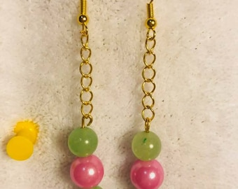 green beads with pink pearls on gold chain