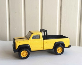Yellow Vintage Tonka Truck toy car