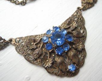 Vintage blue rhinestone necklace, antique bronze necklace, bronze bib necklace, blue glass necklace, bronze metal, linked panels, Art Deco