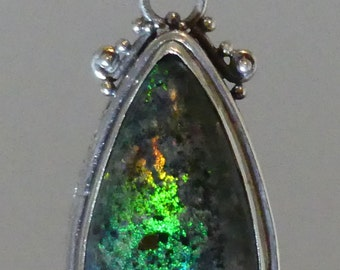 Opal Pendant, Solid Andamooka Matrix. Teardrop, green, topped with a red orange flame set in Balinese Stirling Silver.