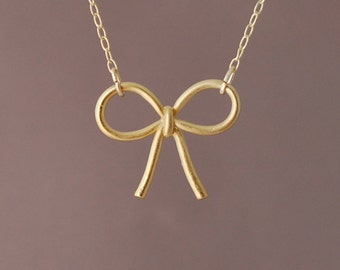 Sweet Bow Gold Necklace also in Silver