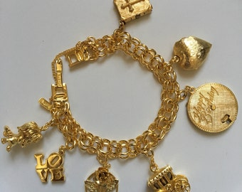 Vintage signed Monet Charm Bracelet with Mechanicals gold tone 1960s