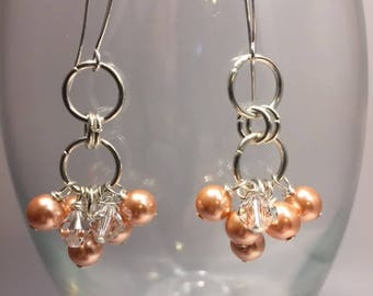 Cluster earrings, Swarovski crystals and peach pearls