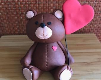 Brown Bear with heart balloon