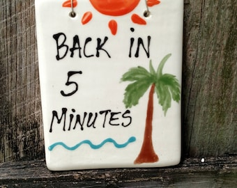Back in 5 minutes hanging sign.