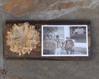 Dark walnut stained wooden photo display