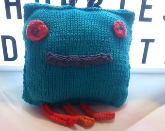 hand knitted Martian plush