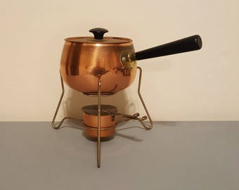 Coppercraft guild fondue pot.