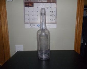 Big antique liquor bottle