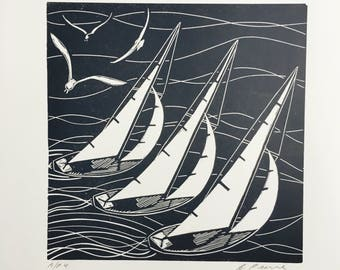 Linocut print of sailing boats
