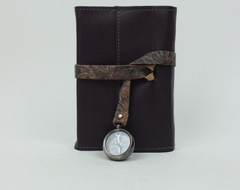Refillable leather journal with leather wrap and compass