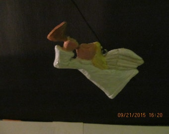 A Set Of 4 Hand Carved Christmas Angel Ornaments