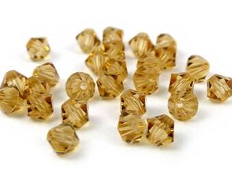 50 x® 4 mm LIGHT COLORADO TOPAZ Swarovski Crystal bicones