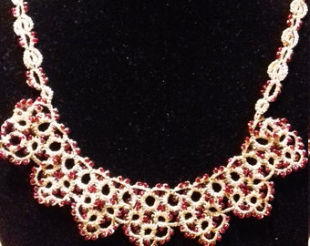 Wire Necklace of pink. tatting and red beads.