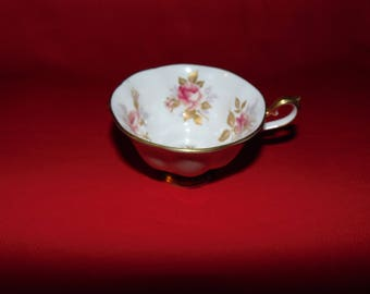 "One (1), 2 3/8"" Bone China, Teacup, from Royal Albert, in a Rose Pattern."