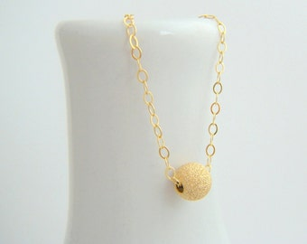 tiny gold bead necklace. 14k 14 k yellow gold filled ball. sparkly stardust finish round small dainty simple everyday delicate jewelry 6 mm