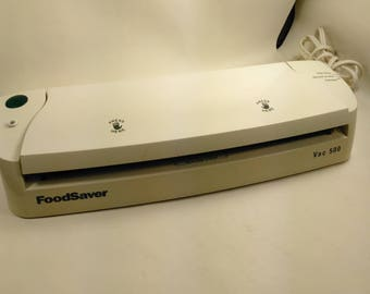 "FoodSaver Vac 500/Bag Sealer/With An Assortment Of Bags/ Sealing Element Is 12.5"" long/Pre-Owned/Great Condition"